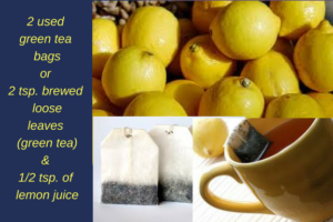 yellow lemons, teabags, and yellow ceramic tea cup with teabag