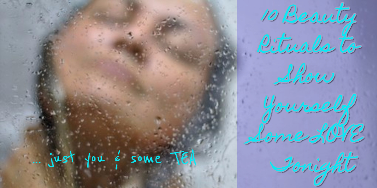 face of woman looking up in shower with water splashing in face
