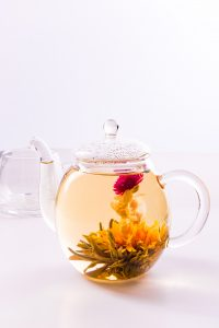blooming tea in lass teapot